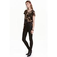 H&M Elastyczne spodnie 0350118002 Czarny