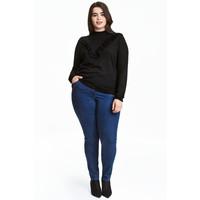 H&M H&M+ Elastyczne spodnie 0352811023 Ciemnoniebieski denim/Raw