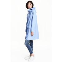 H&M Płaszcz przeciwdeszczowy 0477278003 Jasnoniebieski
