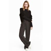 H&M Szerokie spodnie bez zapięcia 0454438002 Czarny/Paski